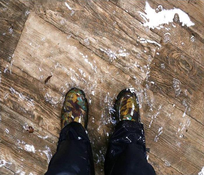 Waterproof Boots, Standing in a Flooded property with Vinyl Wood Floors