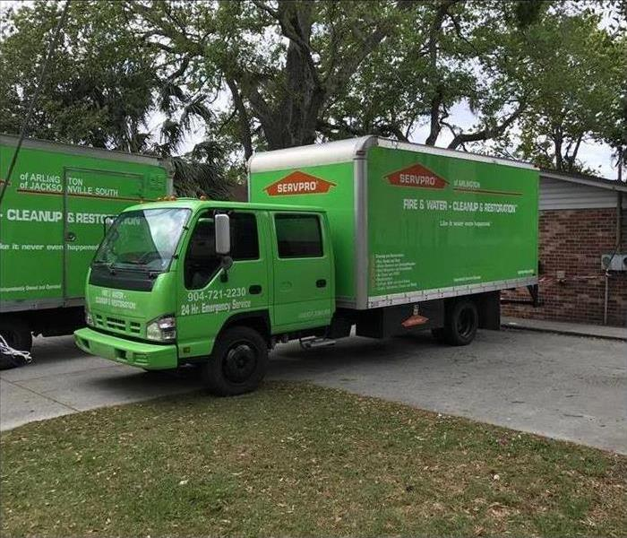 Our green box truck outside a home